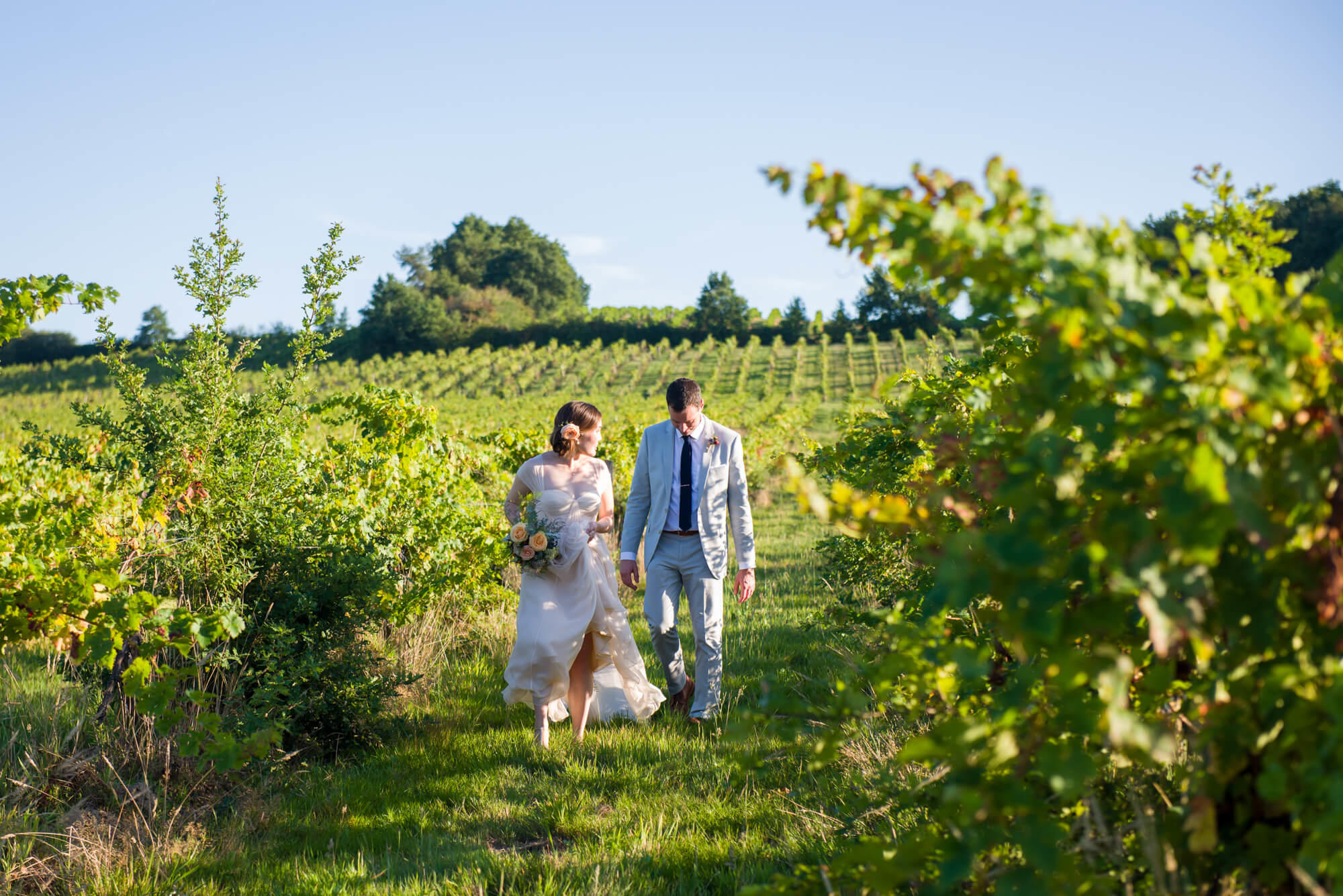 bride and groom in the vines at chateau riguad