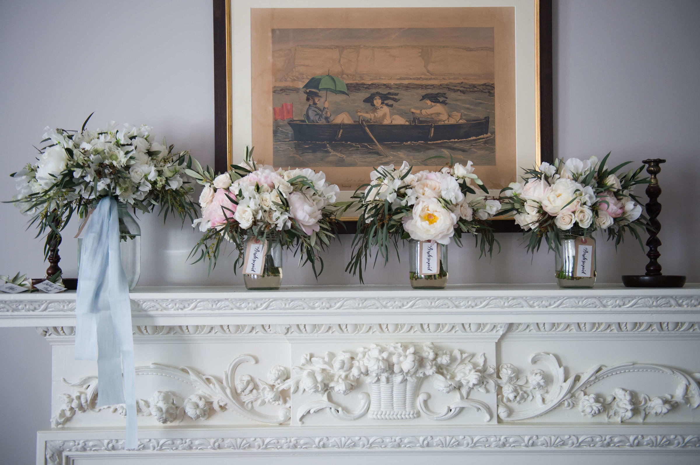 bridal bouquets on the mantel piece at the pig on the beach