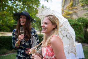 a guest at a wedding with a lace parasol