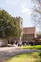 guests waiting outside a church in surrey for the wedding to begin