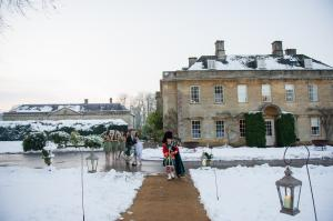 babington house wedding venue in winter with snow on the ground