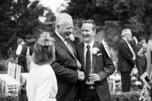 groom and his father at outdoor wedding ceremony in the cotswolds