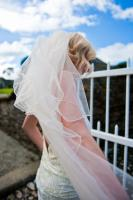bride with windswept veil at boconnoc house in cornwall