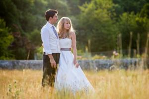 bride and groom at sunset in field behind birling manor in east sussex