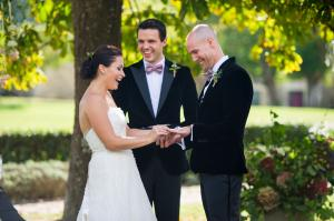 bride and groom exchanging rings at their chateau rigaud wedding near bordeaux
