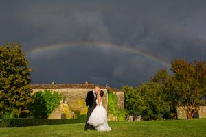 bride in her watters gown beneath the rainbow at chateau rigaud