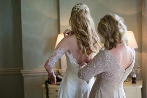 bride and her mother getting into wedding dress by sarah seven at babington house wedding