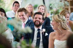 guests enjoying the speeches at this marquee wedding in reigate