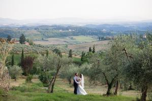 bride and groom in the olives groves at cinciano wedding in tuscany photography by especially amy