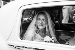 arrival of the bride in a classic car to her church wedding ceremony in winchester