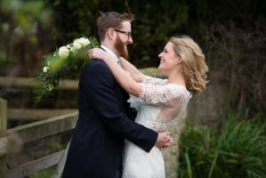bride and groom at their clock barn in hampshire wedding
