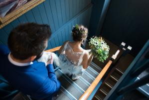 bride walking down the stairs at rosendale pub wedding ceremony in west dulwich london