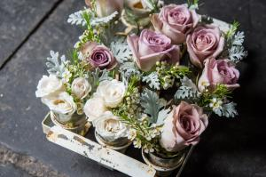button holes made of roses and rosemary at babington house by passion florist