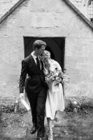 bride and groom happily leaving church in oxfordshire