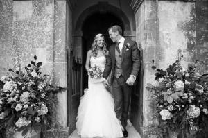 couple exiting st margarets chapel at babington house after their beautiful babington house wedding